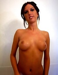 Ponytailed brunette ex-girlfriend slut Destiny plays with her round tits and pink pussy in bath tube