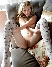 Curly Haired Blonde Babe Showing Her Beauty Through Her Tight Pussy And Sexy Glare While She Poses W