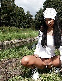 Raven haired teen Melanie showing her sexy ass outdoors