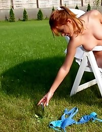 Fiery redheaded teen babe strips and toys her delicious slit outdoors