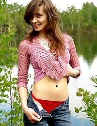 Coed Strips Near A Lake Pulling Down Her Jeans, Taking Off Her Blouse, Bra And Finally Panties