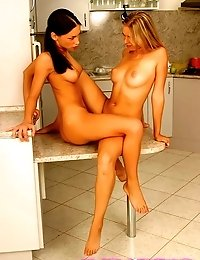Two stunning girlfriends licking their wet pussies in the kitchen