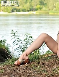 Gorgeous Teen With Splendid Dark Hair And Perfectly Shaped Body Poses Naked In The Woods.