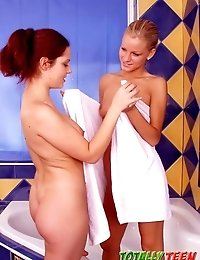 Two heavenly teen babes licking their tiny beavers in the bath tube