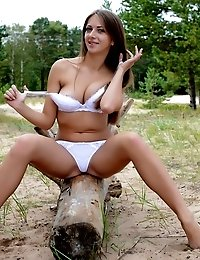 Fascinating Busty Long Haired Honey Showing Her Perfect Body Outdoor On A Large Tree Root.
