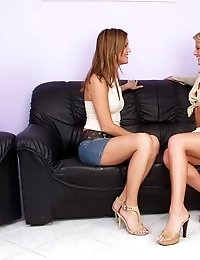 Two amazing girlfriends licking their bald beavers on the couch